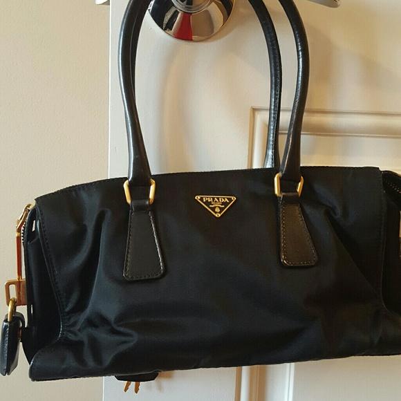 Sale Prada Purse. M 5a810b4c9cc7ef030de1d51e. Other Bags you may like. Black  Prada nylon shoulder ... 1ba00228e0